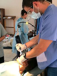 Jeff Goldsmith Performing Dental Procedure in Uganda